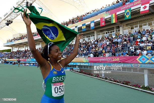 Rosangela Santos of Brazil celebrates winning the gold medal in the women's 100m final during Day 11 of the XVI Pan American Games at Telmex Stadium...