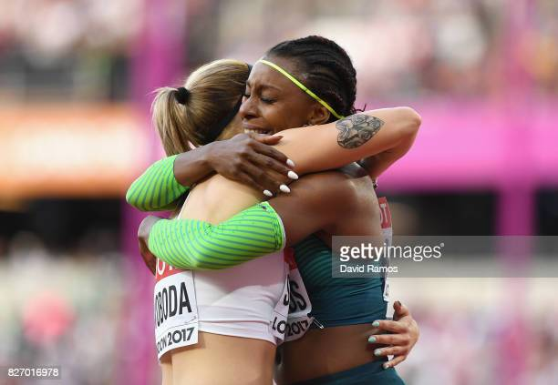 Rosangela Santos of Brazil hugs Ewa Swoboda of Poland after their women's 100 Metres semi final during day three of the 16th IAAF World Athletics...