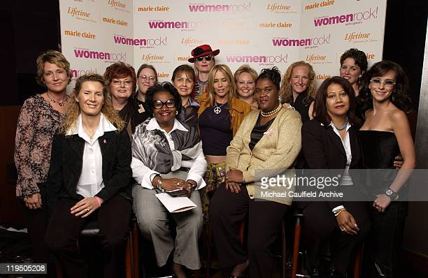 Rosanna Arquette and Jennifer Love Hewitt pose with survivors of breast cancer during arrivals at 'Women Rock Girls and Guitars' airing on the...