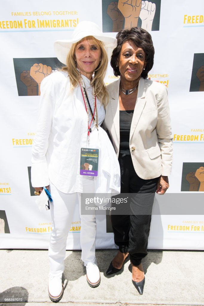 Rosanna Arquette and Maxine Waters attend 'Families Belong Together - Freedom for Immigrants March Los Angeles' at Los Angeles City Hall on June 30, 2018 in Los Angeles, California.
