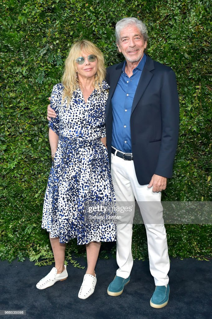 Rosanna Arquette (L) and Todd Morgan attend Chanel Dinner Celebrating our Majestic Oceans, A Benefit for NRDC at Private Residence on June 2, 2018 in Malibu, California.