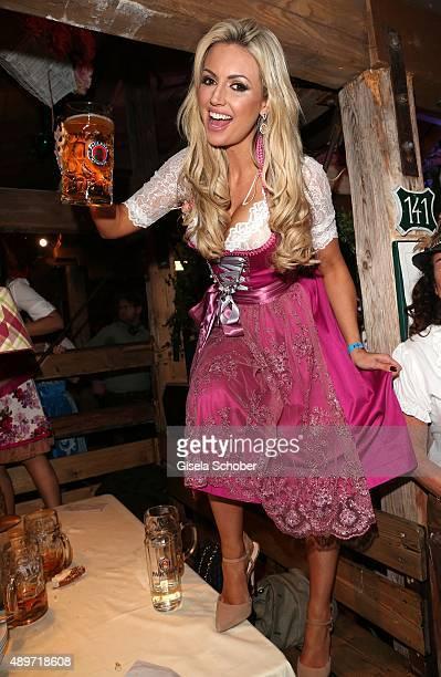 Rosanna Davison wearing a pink dirndl by Alpenmaedel during the 'Haarwerk Blond' Wiesn during the Oktoberfest 2015 at Kaeferschaenke beer tent at...