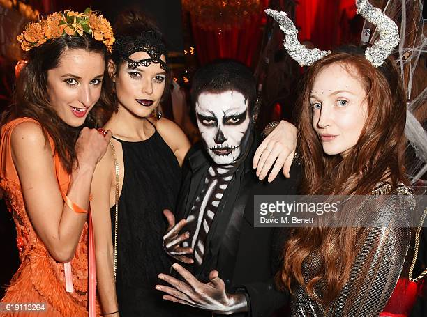 Rosanna Falconer Sarah Ann Macklin guest and Olivia Grant attend Halloween at Annabel's at 46 Berkeley Square on October 29 2016 in London England