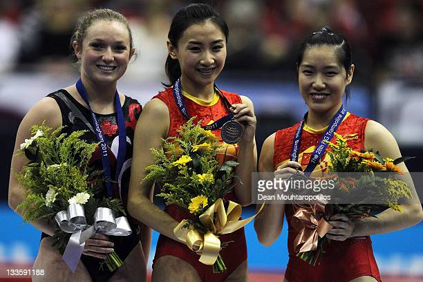 Rosannagh MacLennan of Canada Wenna He of China and Dan Li of China pose after the Individual Trampoline Womens Final during the 28th Trampoline and...