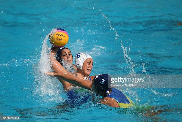 Rosaria Aiello of Italy shoots under pressure from Marina Zablith of Brazil during Water Polo Preliminary Round Group B match on Day 4 of the Rio...