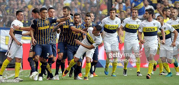 Rosario Central's forward Teofilo Gutierrez argues with Boca Juniors' forward Ricardo Centurion after scoring during their Argentina First Division...