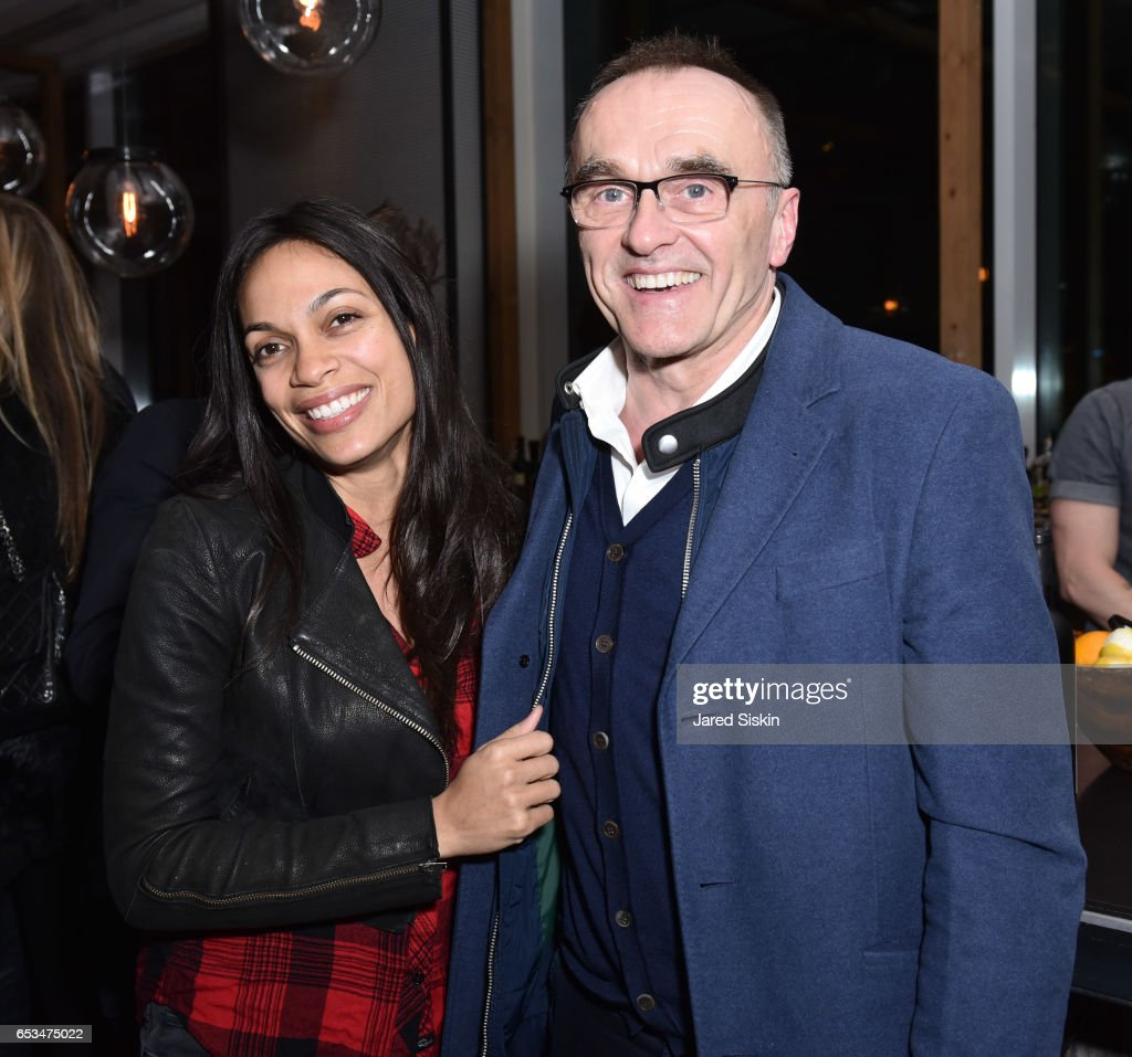Rosario Dawson and Danny Boyle attend TriStar Pictures & The Cinema Society with 19 Crimes Host the After Party for 'T2 Trainspotting' at Mr. Purple at the Hotel Indigo LES on March 14, 2017 in New York City.
