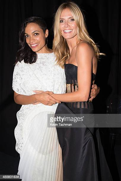 Rosario Dawson and Heidi Klum attend the amfAR Milano 2014 Gala Dinner and Auction as part of Milan Fashion Week Womenswear Spring/Summer 2015 on...