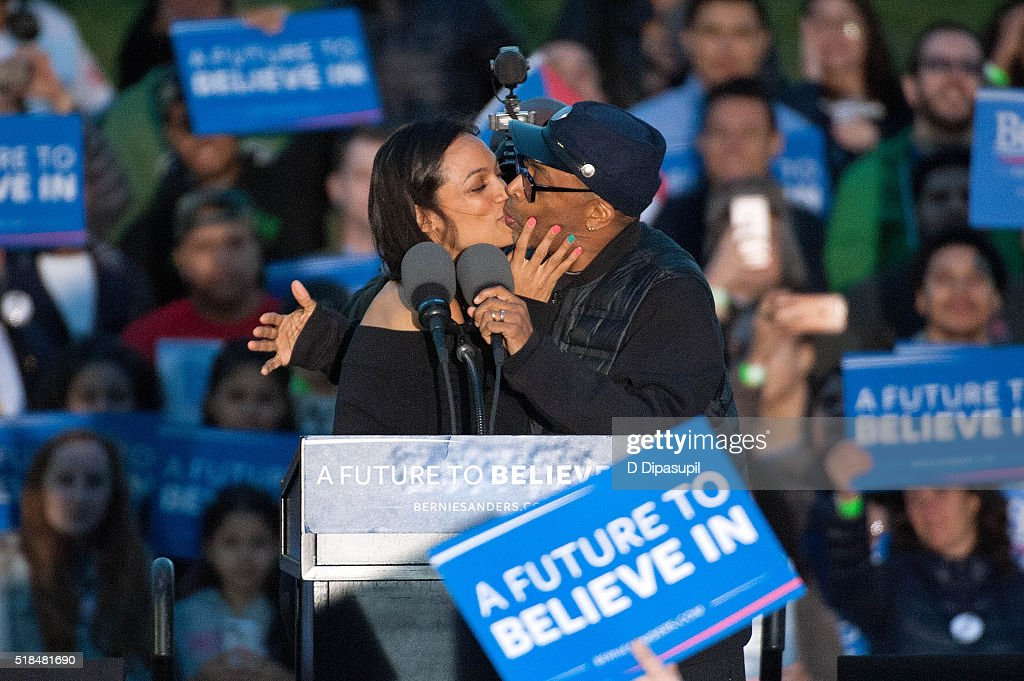 Rosario Dawson (L) and Spike Lee kiss onstage at a campaign event for 2016 Democratic presidential candidate U.S. Senator Bernie Sanders (D-VT) at Saint Mary's Park on March 31, 2016 in New York City.