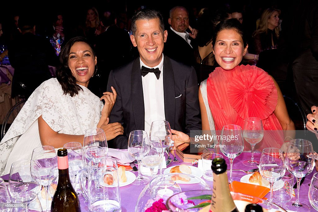 Rosario Dawson (L) attends the amfAR Milano 2014 - Gala Dinner and Auction as part of Milan Fashion Week Womenswear Spring/Summer 2015 on September 20, 2014 in Milan, Italy.