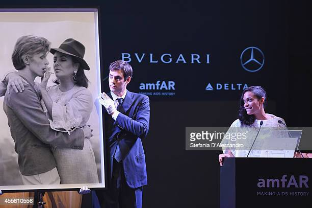 Rosario Dawson is seen on stage during the amfAR Milano 2014 Gala Dinner and Auction as part of Milan Fashion Week Womenswear Spring/Summer 2015 on...