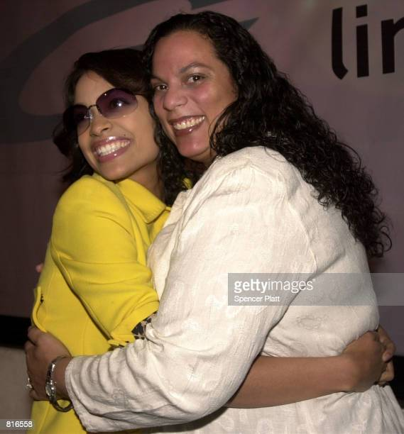 Rosario Dawson left poses with her mother Isabell March 22 2001 at a launch party for Sama Line 3 sunglasses in New York