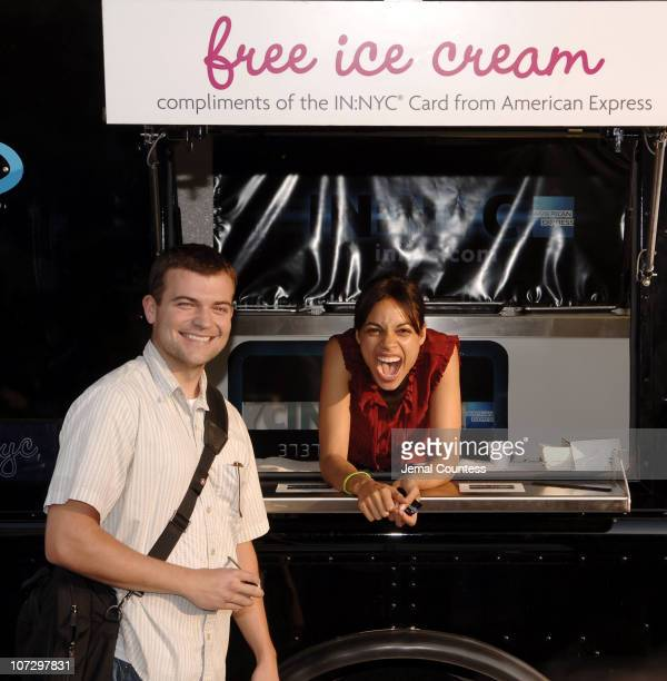 Rosario Dawson serves ice cream to a passer by during Rosario Dawson and American Express Scoop Out Relief to New Yorkers in Union Square at Union...