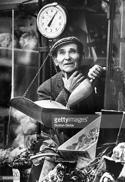 Rosario Mogavero weighs chestnuts for a customer at a store on Bartlett Street in Boston's North End on Dec 7 1978