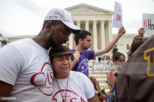 Rosario Reyes an undocumented mother from El Salvador reacts to news on a Supreme Court decision blocking Obama's immigration plan which would have...