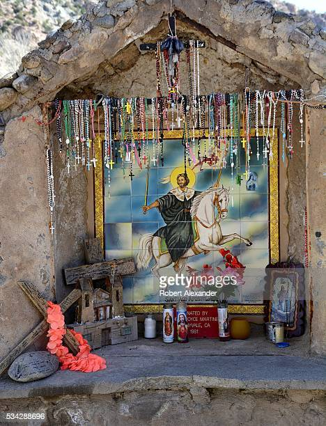 Rosary beads hang in an outdoor shrine dedicated to Saint James the Apostle at the Santuario de Chimayo in Chimayo New Mexico on February 27 2016...