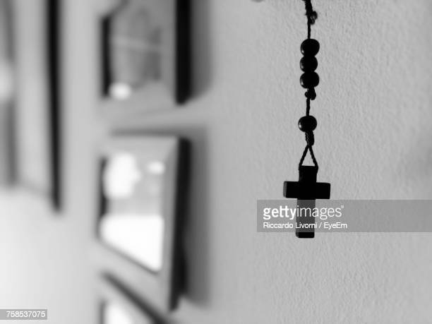 Rosary Hanging By Wall At Home