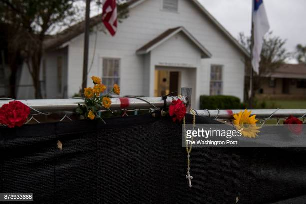 A rosary hangs on the fence surrounding the Sutherland Springs First Baptist Church one week after 26 people were killed inside in Sutherland Springs...