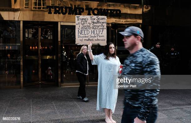 Rosary Solimanto who has multiple sclerosis and fears for her finances holds a protest outside of Trump Tower over the Republican administration's...
