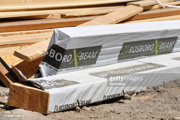 Rosboro LLC wood beams sits stacked at the construction site of a new home in Park City Utah US on Friday Aug 14 2020 US home construction starts...