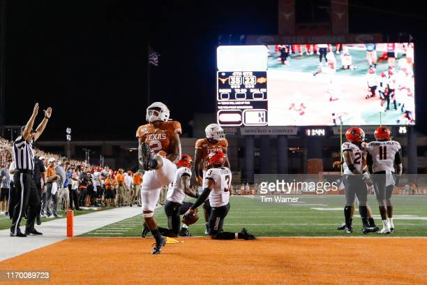 Roschon Johnson of the Texas Longhorns celebrates after scoring a two point conversion in the fouth quarter against the Oklahoma State Cowboys at...