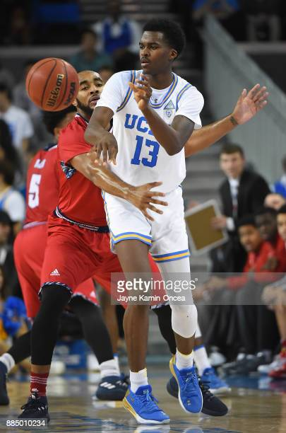 Roschon Prince of the Detroit Mercy Titans defends Kris Wilkes of the UCLA Bruins as he passes the ball in the first half of the game at Pauley...