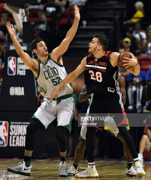 Rosco Allen of the Boston Celtics guards RJ Hunter of the Portland Trail Blazers during the 2017 Summer League at the Thomas Mack Center on July 9...