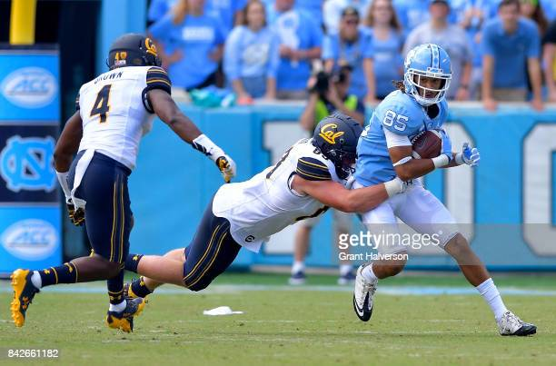 Roscoe Johnson of the North Carolina Tar Heels makes a catch against the California Golden Bears during their game at Kenan Stadium on September 2...