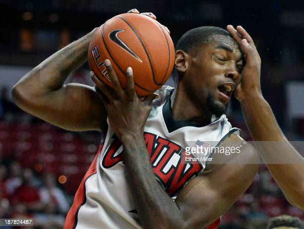 Roscoe Smith of the UNLV Rebels gets hit in the head as he rebounds the ball during a game against the UC Santa Barbara Gauchos at the Thomas Mack...