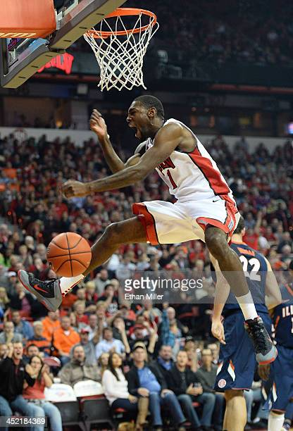 Roscoe Smith of the UNLV Rebels reacts after dunking against the Illinois Fighting Illini during their game at the Thomas Mack Center on November 26...
