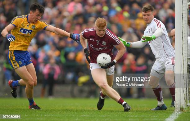 Roscommon Ireland 17 June 2018 Seán Andy Ó Ceallaigh of Galway supported by teammate Ruairí Lavelle in action against Tadhg O'Rourke of Roscommon...