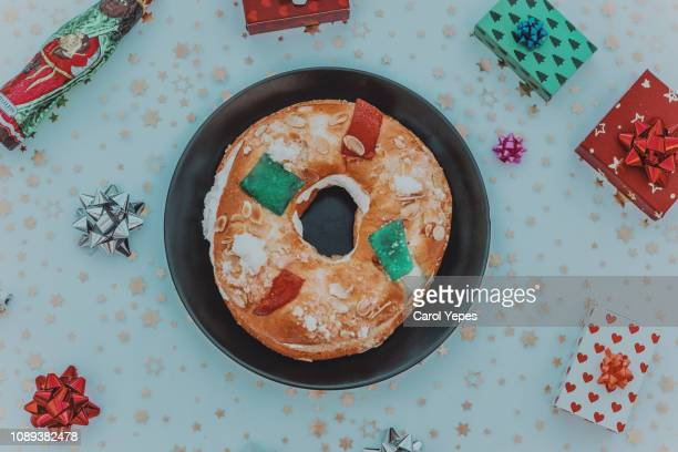 roscon de reyes, kings' ring typical dessert eaten in spain to celebrate epiphany or dia de reyes magos - roscon de reyes stock pictures, royalty-free photos & images