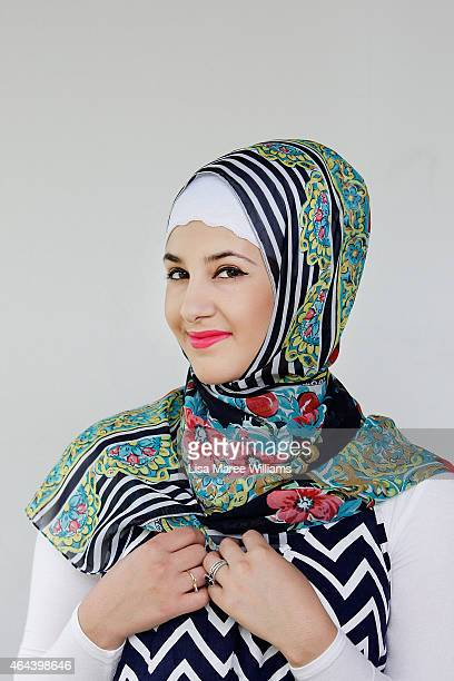 Rose Agha poses for a portrait whilst visiting Sara Elmir's home clothing studio on December 4 2014 in Bankstown Australia Sara Elmir 26 and mother...