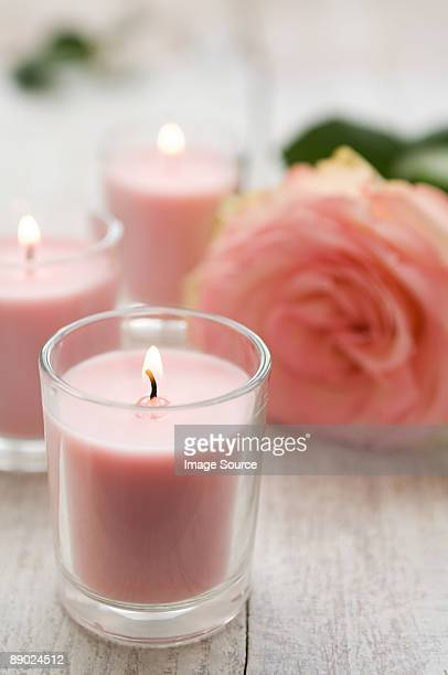 rose and candles - candle stock pictures, royalty-free photos & images