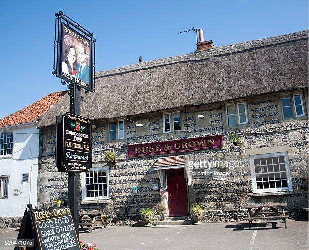 Rose and Crown pub at Tilshead, Wiltshire, England with pub sign painted of Prince William and his wife Kate Middleton.