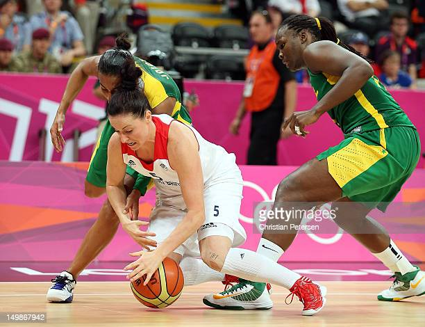 Rose Anderson of Great Britain dives for a loose ball with Karla Costa and Clarissa Santos of Brazil during the Women's Basketball Preliminary Round...
