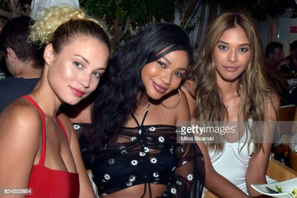 Rose Bertram Chanel Iman and Heidy De La Rosa pose for a photo during the Velocity Black party on July 29 2017 in Mykonos Greece