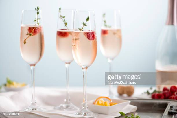 rose champagne cocktails - refreshment stock pictures, royalty-free photos & images