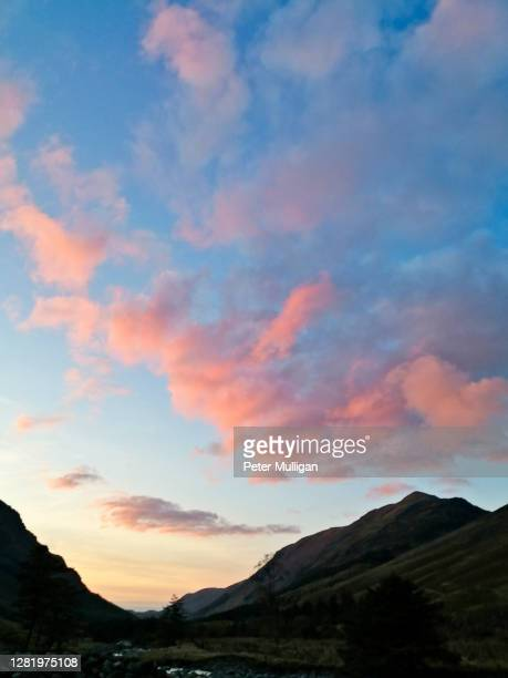 rose coloured sunset in ennerdale; english lake district - pink colour stock pictures, royalty-free photos & images