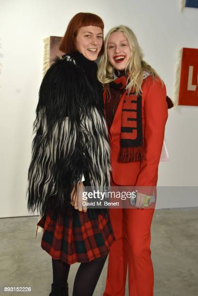Rose Easton and Harriet Varney attend a private view of artist Joe Sweeney's new exhibition 'Loose Change' at The Cob Gallery on December 14 2017 in...