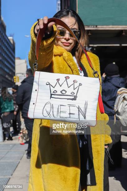 Rose Ferreira is seen wearing a yellow ASOS coat and a Dolce Gabbana bag on the street during New York Fashion Week on February 9 2019 in New York...