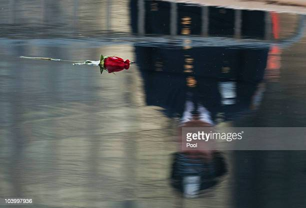 A rose floats in the reflecting pool at Ground Zero during the annual 9/11 memorial service September 11 2010 in New York City People gathered at the...