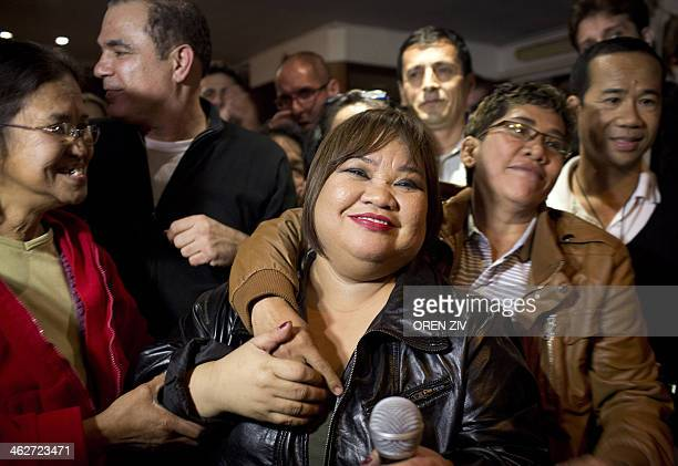 Rose Fostanes a Filipina migrant caregiver living in Israel celebrates with friends and family in a bar in South Tel Aviv after she won in the...