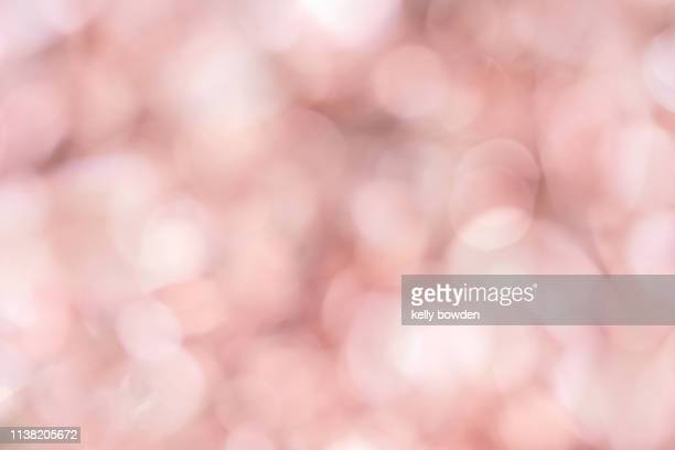 rose gold bokeh lights background - ローズゴールド ストックフォトと画像