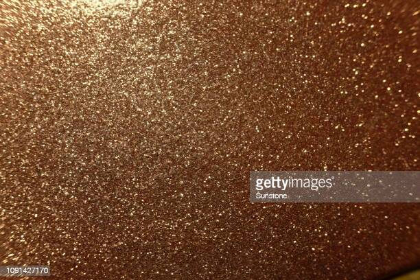 rose gold glitter texture - glam rock stock pictures, royalty-free photos & images