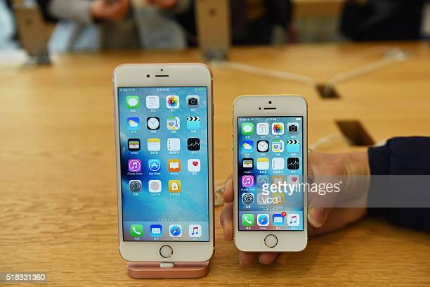 A rose gold iPhone SE and an iPhone 6S Plus are seen at an Apple Store on March 31 2016 in Hangzhou Zhejiang Province of China Apple launched a new...