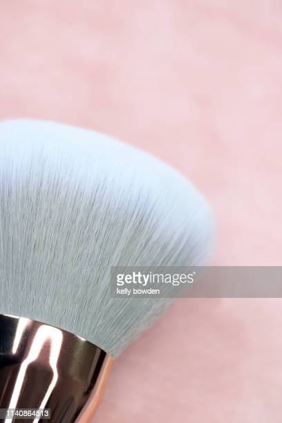 rose gold make up brush - kelly bowden stock pictures, royalty-free photos & images