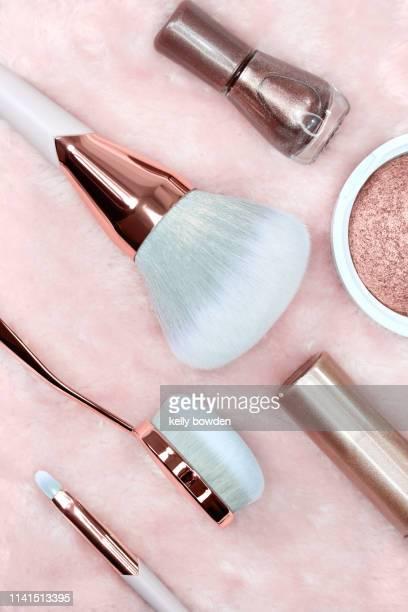 rose gold make up brushes nailvarnish flat lay - ローズゴールド ストックフォトと画像