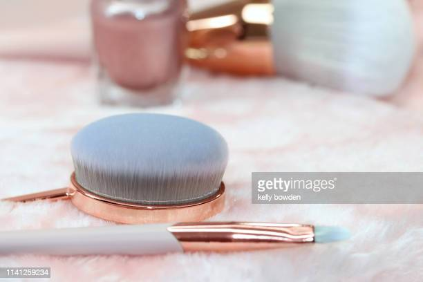 rose gold makeup brushes cosmetics beauty - kelly bowden stock pictures, royalty-free photos & images
