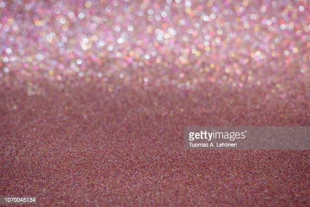 rose gold or red glitter full frame shiny abstract background with vignetting, shallow depth of field. - rose gold stock pictures, royalty-free photos & images